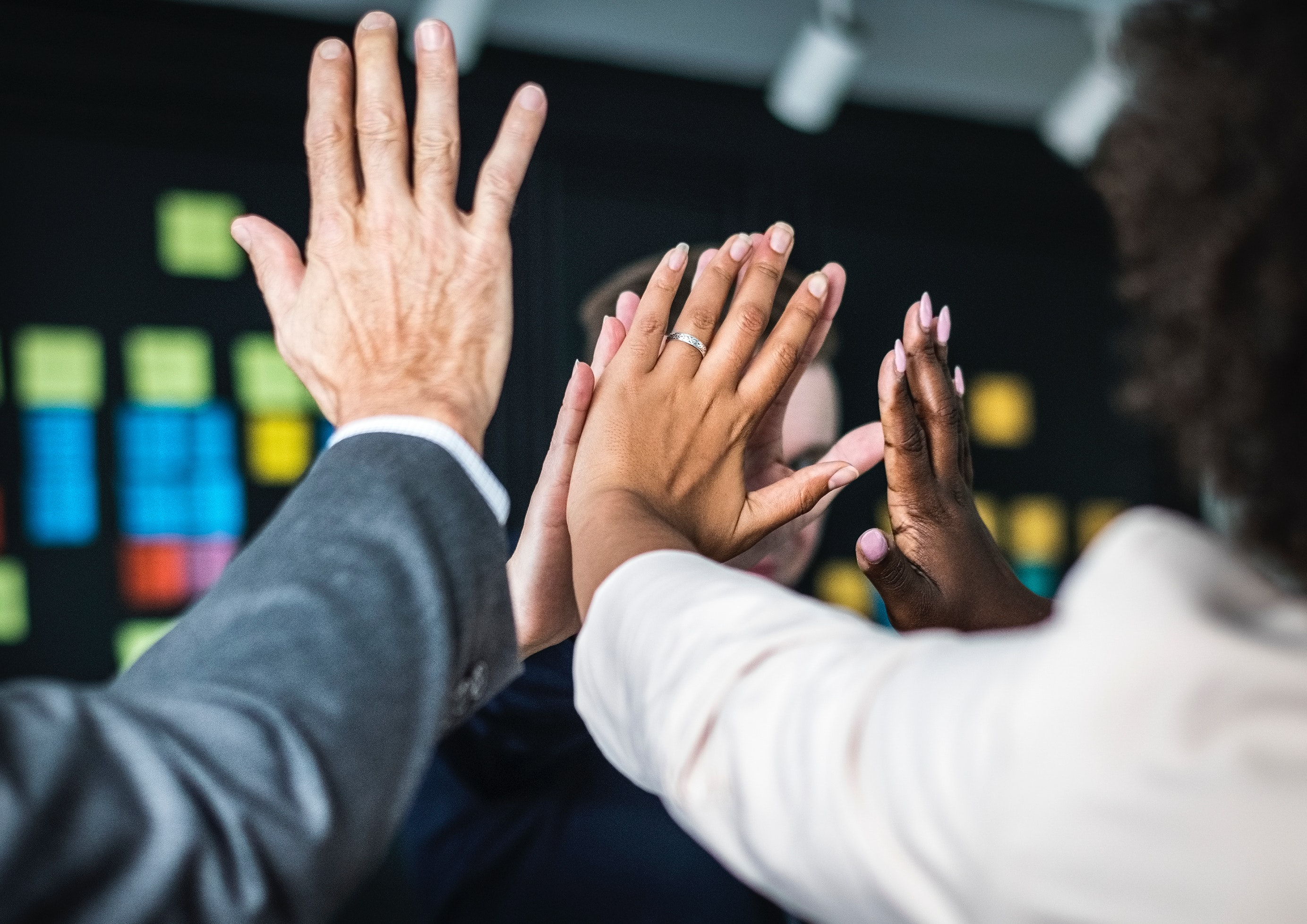 People joining hands in achievement
