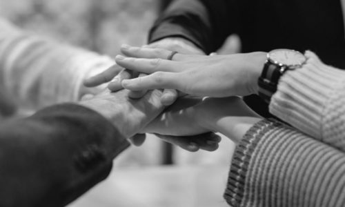 People joining hands as a team